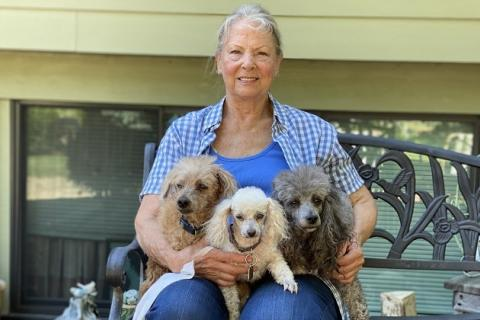 Pet food donation recipient, Gloria, and her poodles