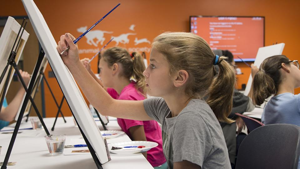 Girl painting at Paint My Pet Program