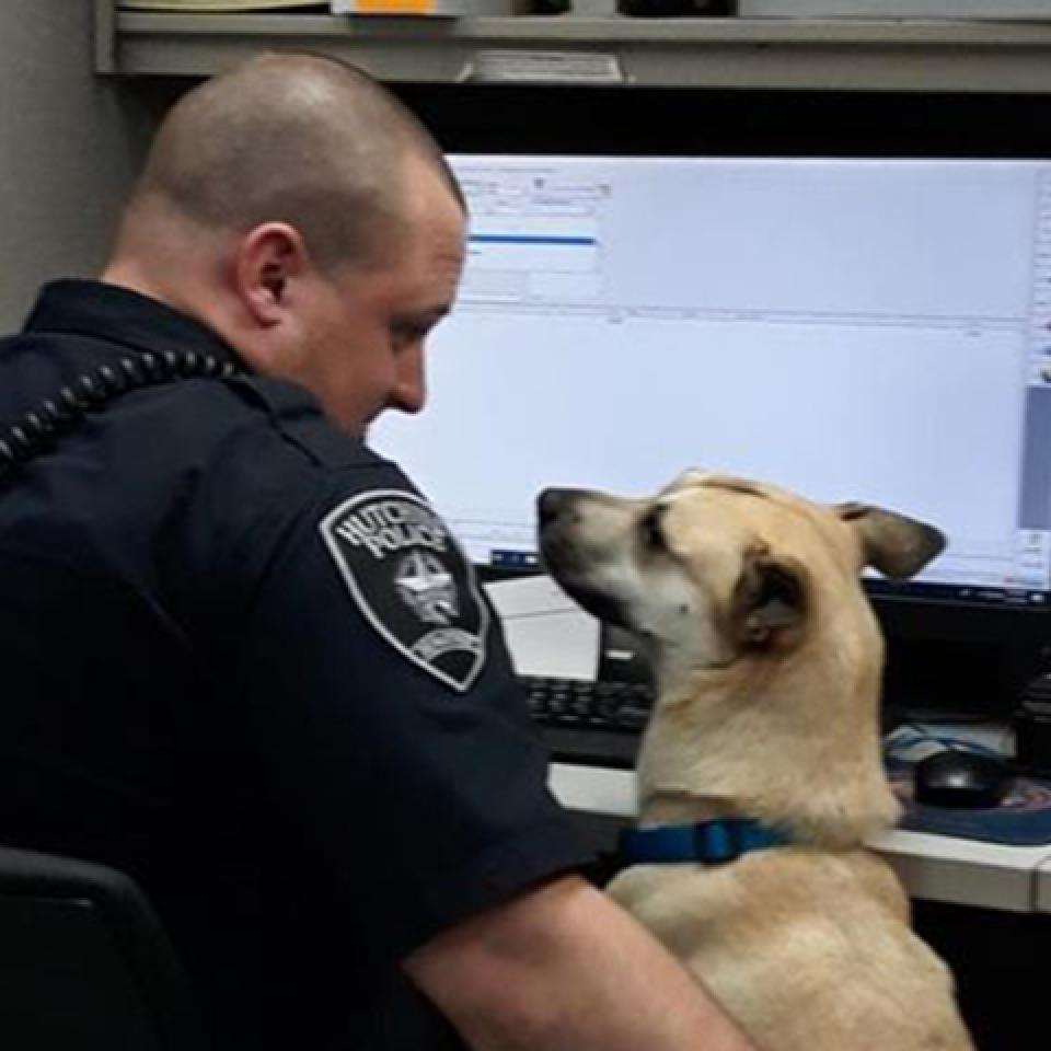Deeogie and a police officer